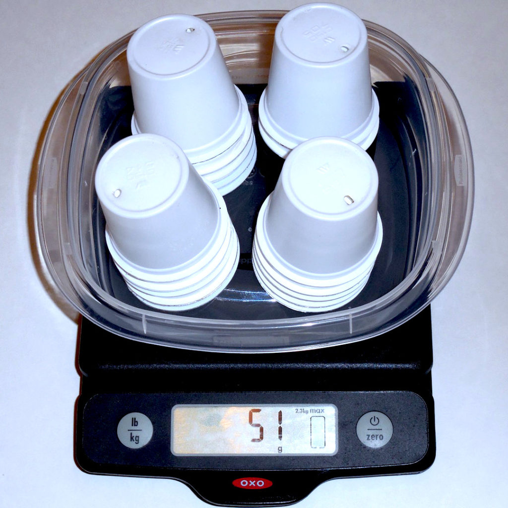 20 k-cups on a scale showing a weight of 51 grams